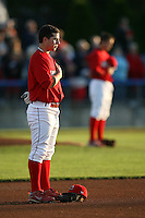 August 31, 2009:  First Baseman Alan Ahmady of the Batavia Muckdogs stands during the National Anthem with Pitcher Michael Blazek in the background before a game at Dwyer Stadium in Batavia, NY.  The Muckdogs are the Short-Season Class-A affiliate of the St. Louis Cardinals.  Photo By Mike Janes/Four Seam Images