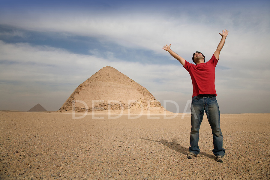A male toursit happy to be visiting the Bent Pyramid, located 10km south of Saqqara in Dahshur, Egypt.