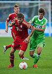 Thomas Muller of Bayern Munich and Ferhan Hasani of VfL Wolfsburg in action during a friendly match as part of the Audi Football Summit 2012 on July 26, 2012 at the Guangdong Olympic Sports Center in Guangzhou, China. Photo by Victor Fraile / The Power of Sport Images