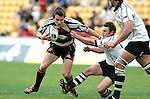 Ben Meyer is scragged by Danny Lee during the Air New Zealand Cup rugby game between Counties Manukau & Hawkes Bay played at Mt Smart Stadium, 30th of September 2006. Hawkes Bay won 30 - 29.