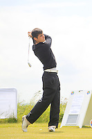 Greg Mungovan (Headfort) on the 1st tee during Round 1 of the Irish Amateur Close Championship at Seapoint Golf Club on Saturday 7th June 2014.<br /> Picture:  Thos Caffrey / www.golffile.ie