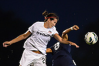 Washington Spirit midfielder Holly King (20) goes up for a header with Sky Blue FC forward Monica Ocampo (8). Sky Blue FC defeated the Washington Spirit 1-0 during a National Women's Soccer League (NWSL) match at Yurcak Field in Piscataway, NJ, on August 3, 2013.