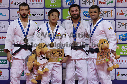 Gold medalist Ryuju Nagayama (2nd L) of Japan, silver medalist Albert Oguzov (L) of Russia with bronze medalists Robert Mshvidobadze of Russia and Amiran Papinashvili of Georgia celebrate their victory during an awards ceremony after the Men -60 kg category at the Judo Grand Prix Budapest 2018 international judo tournament held in Budapest, Hungary on Aug. 10, 2018. ATTILA VOLGYI