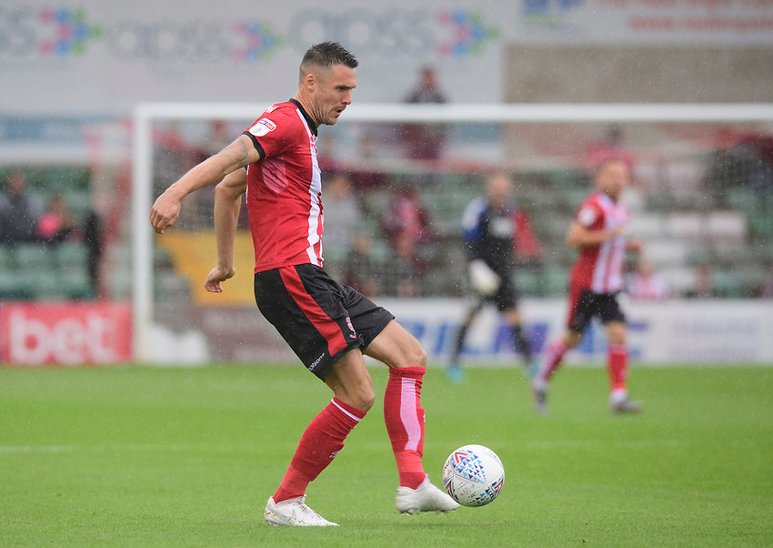 Lincoln City's Jason Shackell<br /> <br /> Photographer Chris Vaughan/CameraSport<br /> <br /> The EFL Sky Bet League One - Lincoln City v Fleetwood Town - Saturday 31st August 2019 - Sincil Bank - Lincoln<br /> <br /> World Copyright © 2019 CameraSport. All rights reserved. 43 Linden Ave. Countesthorpe. Leicester. England. LE8 5PG - Tel: +44 (0) 116 277 4147 - admin@camerasport.com - www.camerasport.com