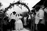 A Zapotec newly-married couple arrives at their home during their wedding ceremony in Coatecas Altas village, Oaxaca, November 22, 1998. Most of the villagers of Coatecas leave their home to harvest in northern state of Sinaloa.  © Photo by Heriberto Rodriguez
