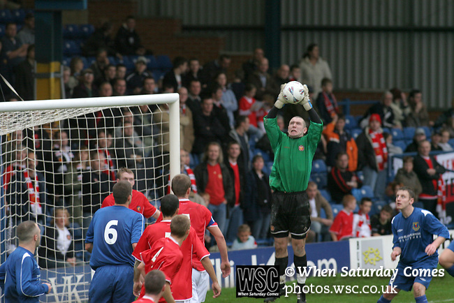 FC United of Manchester 8, Glossop North End 0, 28/10/2006. Gigg Lane, Bury, North West Counties League division one. FC United of Manchester goalkeeper Sam Ashton catching the ball as his team take on Glossop North End (blue shirts) in a North West Counties division one match at United's home stadium, Gigg Lane, home to Bury FC. The match was staged on People United Day, an event started in 1999 which brought together fans from across Europe to campaign against racism. FC United were formed in the summer of 2005 by supporters of Manchester United in response to the take over of their club by American millionaire Malcolm Glazer and his family. The club entered the football pyramid at the lowest level with the intention to climbing through the leagues. FCUM won the match 8-0, watched by 3257 spectators. Photo by Colin McPherson.