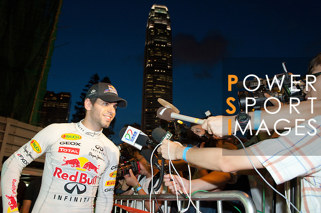 Red Bull Toro Rosso driver Jaime Alguersuari talks to the media after the Red Bull Dragon Run 2011 in Hong Kong, China on the 18th June 2011.