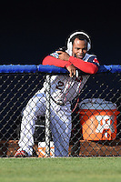 Salem Red Sox outfielder Matty Johnson (2) listens to music in the dugout before a game against the Lynchburg Hillcats on April 25, 2014 at Lewisgale Field in Salem, Virginia.  Salem defeated Lynchburg 10-0.  (Mike Janes/Four Seam Images)