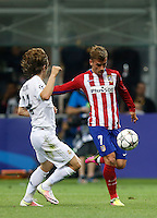 Calcio, finale di Champions League: Real Madrid vs Atletico Madrid. Stadio San Siro, Milano, 28 maggio 2016.<br /> Atletico Madrid Antoine Griezmann, left, is challenged by Real Madrid's Luka Modric during the Champions League final match between Real Madrid and Atletico Madrid, at Milan's San Siro stadium, 28 May 2016.<br /> UPDATE IMAGES PRESS/Isabella Bonotto