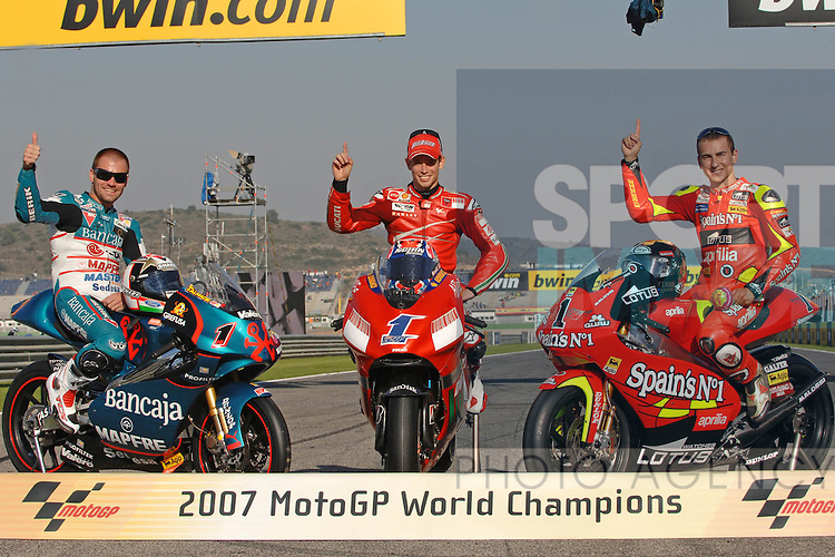 Gabor Talmacsi 125cc, Casey Stoner and Jorge Lorenzo 250cc pose with their bikes as he 2007 MotoGP World Champions