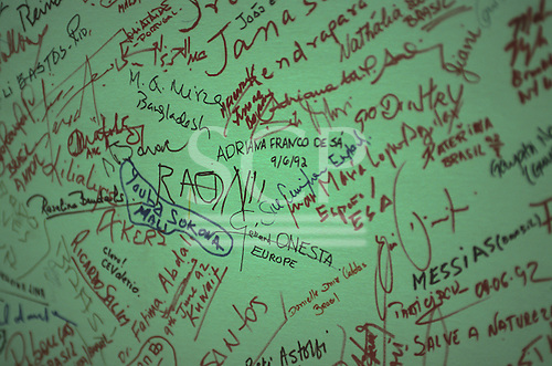 United Nations Conference on Environment and Development, Rio de Janeiro, Brazil, 3rd to 14th June 1992. Pledge signatures from all over the world on a wall, including Chief Raoni of the Kayapo
