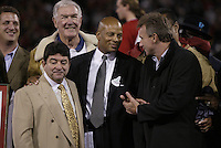 Football: Ronnie Lott, center, Joe Montana, right and Eddie DeBartolo at the halftime ceremony retiring Lott's #42 jersey during the Pittsburgh Steelers vs. San Francisco 49ers game played at Candlestick Park in San Francisco, California. November 17, 2003. Photo by Brad Mangin.