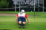 Stuart Manley's caddy does a few push-ups on the 18th green during Day 2 of the BMW Italian Open at Royal Park I Roveri, Turin, Italy, 10th June 2011 (Photo Eoin Clarke/Golffile 2011)