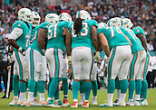 04.10.2015. Wembley Stadium, London, England. NFL International Series. Miami Dolphins versus New York Jets. Miami Dolphins offence in a huddle before a play.