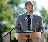 STAFF PHOTO ANDY SHUPE - Justin Tennant, member of the Fayetteville City Council, speaks during a dedication ceremony Sunday, Sept. 21, 2014, for the Gehring Cemetery at Christian Life Cathedral in Fayetteville.