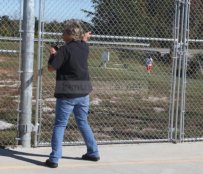 Officer Kay Chambers yells at Amanda Driggers as she makes her escape to the road outside of Three Forks Regional Jail. Photo by Britney McIntosh