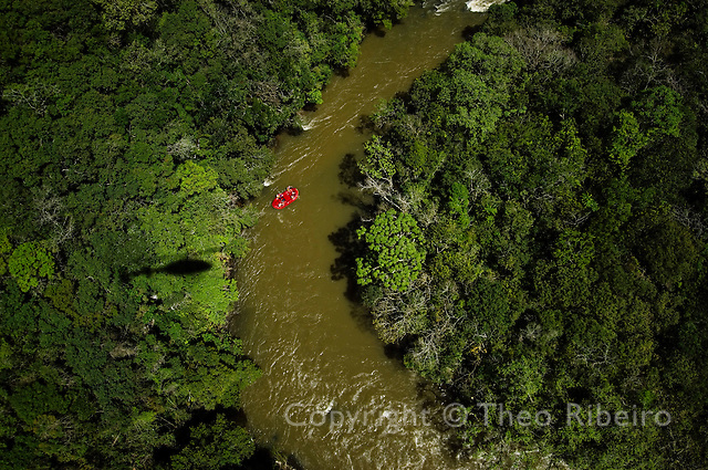 Aerial view of a red boat rafting down a river in a tropical rain forest during the Ecomotion Pro 2005 - Serras Gauchas adventure race. Canela, Rio Grande do Sul, Brazil, Thursday, Oct. 06, 2005.