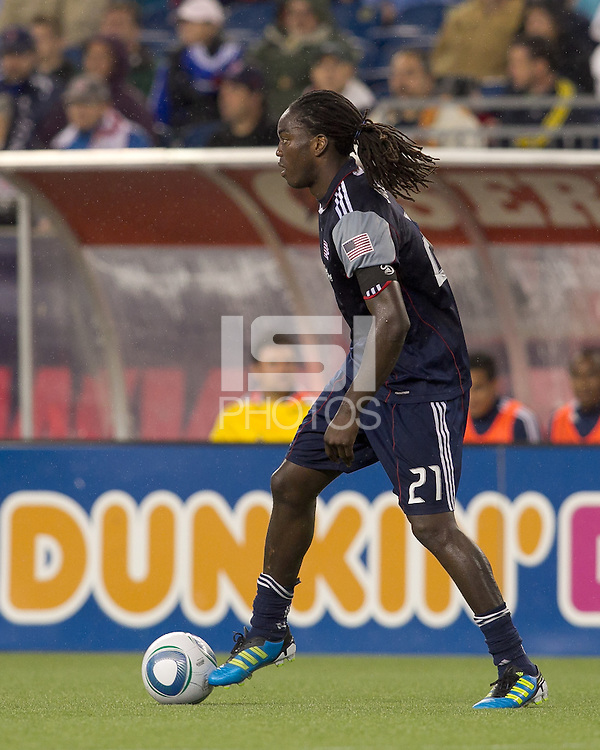 New England Revolution midfielder Shalrie Joseph (21) at midfield. In a Major League Soccer (MLS) match, the New England Revolution defeated the Vancouver Whitecaps FC, 1-0, at Gillette Stadium on May14, 2011.