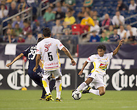 Monarcas Morelia midfielder Jorge Gastelum (8) tackle. The New England Revolution defeated Monarcas Morelia in SuperLiga 2010 group stage match, 1-0, at Gillette Stadium on July 20, 2010.