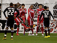 A free kick is blocked by a wall containing Chicago Fire teammates Patrick Nyarko (14), Baggio Husidic (9), Collins John (15) and Krzysztof Krol  at RFK Stadium in Washington, DC.  The Chicago Fire defeated DC United, 2-0.