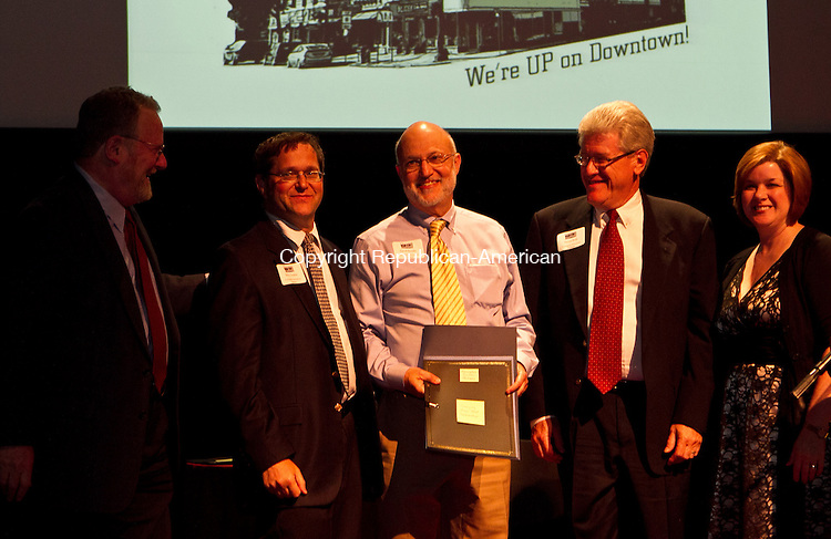 Torrnington, CT-06 June 2011-060611JH04- John Simone,(left) president&ceo of Connecticut Main Street Center and the associate director Kimberley Parsons-Whitaker (far right) present the Award of Excellence for Emerging Main Street Partnership to Torrington Downtown Partners' Steve Temkin, David Bender and Steve Roth during the Connecticut Main Street Awards Gala in Nancy Marine Studio Theatre Monday afternoon in Torrington.   Junfu Han Republican-American