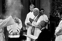 El Papa Juan Pablo II preside misa reunido con el clero y el arzobispo Juan Francisco Fresno en la catedral de Santiago durante su visita a Chile<br /> Santiago Chile Abril 1987.<br /> Forty years ago, on September 11, 1973, a military coup led by General Augusto Pinochet toppled the democratic socialist government of Chile. President Salvador Allende was killed during the  attack to seize  La Moneda presidential palace.  In the aftermath of the coup, a quarter of a million people were detained for their political beliefs, 3000 were killed or disappeared and many thousands were tortured.<br /> Some years later in 1981, while Pinochet ruled Chile with iron fist, a young photographer called Juan Carlos Caceres started to freelance in the streets of Santiago and the poblaciones or poor outskirts, showing the growing resistance against the dictatorship. For the next 10 years Caceres photographed every single protest and social movement fighting for the restoration of democracy. He knew that his camera was his only weapon, he knew that his fate was to register the daily violence and leave his images for the History.<br /> In this days Caceres is working to rescue and organize his collection of images in the project Imagenes de la Resistencia   . With support of some Chilean official institutions, thousands of negatives are digitalized and organized to set up the more complete visual heritage of this  violent period of Chile´s history.<br /> In a time when technology was not very friendly and communications were kind of basic, Juan Carlos Caceres and other photojournalist were always at the right place in the right moment defying the threats of the police. Their work is now  a visual heritage that documents and remind us the fight of Chilean people for democracy.