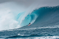 Namotu Island Resort, Nadi, Fiji (Sunday, May 27th 2018): Tom Lowe (UK)<br /> There had been strong SE winds all night along with heavy rain so the ocean was messy at first light. Cloudbreak was big and bumpy at dawn and the namotu boat was the first in the line up. The set waves were in the 15' plus range  and the ocean needed to settle down before any one hit the water.<br /> As the tide dropped it cleaned up and the first surfers paddled out. The first ridden waves were tow-in and in the 20' plus range. The swell was the biggest just after the low tide and stayed in the 15'-20' range for the rest of the day.<br /> Crew paddled and towed into the waves and there were also crew who kite surfed when the wind ws strong enought.<br /> There were strong wind all day and overcast conditions with long periods of rain. The huge swell forecast had big wave surfers flying in from around the world and it had already been call the 'Black Mamba' swell, one of the biggest to hit Fiji in the past six years.  <br /> Photo: joliphotos.com