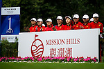 Volunteers on the 1st hole during the Round 1 of the Faldo Series Asia Grand Final at Mission Hills on March 2, 2011 in Shenzhen, China. Photo by Raf Sanchez / Faldo Series