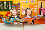 Cait Kirby and  Caoimhe Loghrann, new arrivals in junior infants at Caherlaheen NS on Tuesday