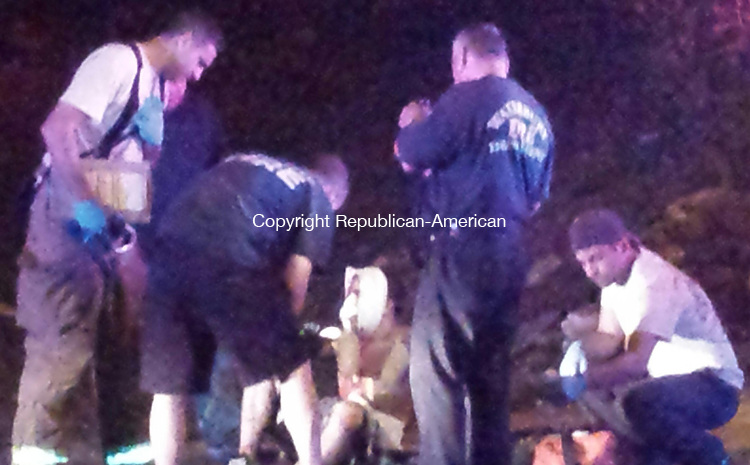 WATERBURY, CT - June 10, 2014 - 06112014LX - Firefighters from Engine 8 tend to a 16-year old stabbing victim on Willow Street on Tuesday night.