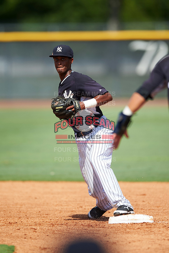 GCL Yankees East shortstop Yonauris Rodriguez (19) throws to first during a game against the GCL Yankees West on August 3, 2016 at the Yankees Complex in Tampa, Florida.  GCL Yankees East defeated GCL Yankees West 12-2.  (Mike Janes/Four Seam Images)