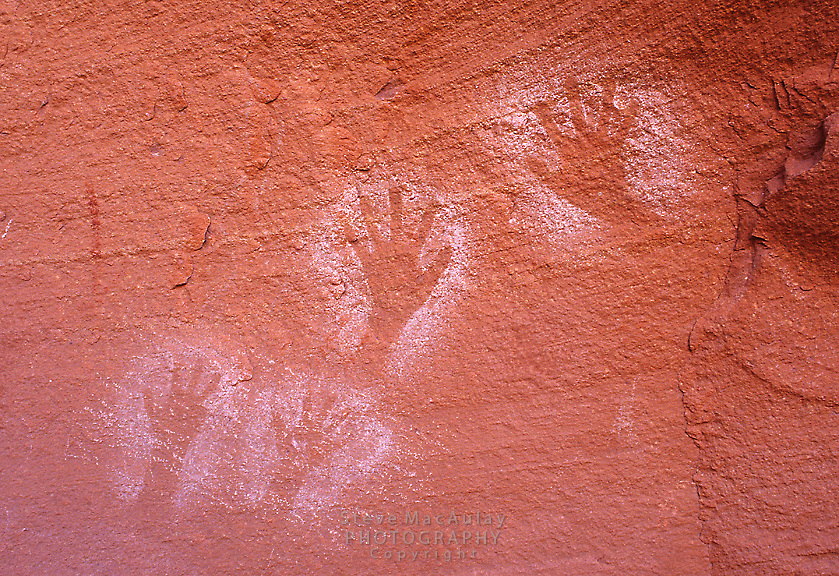 Ancestral Puebloan Anasazi Petroglyphs of human hands createrd by blowing pigment over hand placed on wallGreen River, Canyonlands National Park, Utah