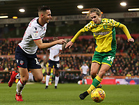 Bolton Wanderers' Pawel Olkowski gets away from Norwich City's Todd Cantwell<br /> <br /> Photographer David Shipman/CameraSport<br /> <br /> The EFL Sky Bet Championship - Norwich City v Bolton Wanderers - Saturday 8th December 2018 - Carrow Road - Norwich<br /> <br /> World Copyright &copy; 2018 CameraSport. All rights reserved. 43 Linden Ave. Countesthorpe. Leicester. England. LE8 5PG - Tel: +44 (0) 116 277 4147 - admin@camerasport.com - www.camerasport.com