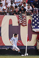 Argentina forward Lionel Messi (18) takes a corner kick. The men's national teams of the United States and Argentina played to a 0-0 tie during an international friendly at Giants Stadium in East Rutherford, NJ, on June 8, 2008.
