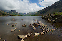 Wast Water (or sometimes Wastwater) lies in a fine example of a glacially over-deepened valley in Cumbria, England, and is, at 258 feet, Britain's deepest lake as well as one of its most beautiful.