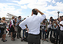 Anthony Weiner speaks to the media during his Keys To The City Tour stop at the Rockaway Beach on Wednesday, August 14, 2013 in New York. (AP Photo/ Donald Traill)