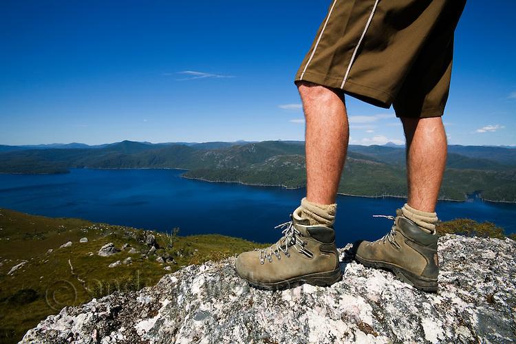 A hiker stands atop Mount Farrell, in Tasmania's western highlands.  Tullah, Tasmania, AUSTRALIA