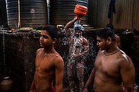 Kushti wrestlers wash themselves after training at Gangavesh Talim on the 17th of September, 2017 in Kolhapur, India.  <br /> Photo Daniel Berehulak for Lumix