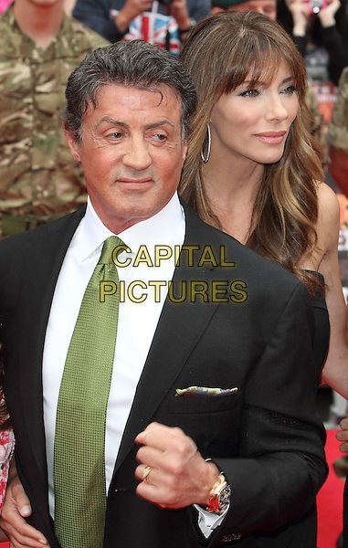 Sylvester Stallone and Jennifer Flavin.'The Expendables 2' UK film premiere held at the Empire Leicester Square,.London, England..13th August 2012.half length black suit white shirt green tie  hand fist married husband wife .CAP/ROS.©Steve Ross/Capital Pictures.