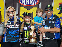 Mar 20, 2016; Gainesville, FL, USA; NHRA top fuel driver Brittany Force (center) celebrates with family members Courtney Force , Jacob Hood and John Force after winning the Gatornationals at Auto Plus Raceway at Gainesville. Mandatory Credit: Mark J. Rebilas-USA TODAY Sports