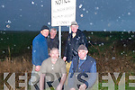 RESIDENTS: Residents from the surrounding areas of the Bridge that collasped at Ballinagar Road, Lixnaw, on Thursday, Mike O'Keeffe, Mike Fealy, Denis Quilter, Jimmy Keane, John McAuliffe, Eilish Keane, Frank Keane, John B Keane and Mairead Keane O'Connor, under the sign by the Kerry County Council in which the bridge was allowed a maximum of 12 tonnes..