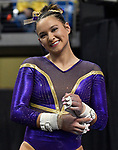 The SEC National Gymnastic Championship was held on Saturday March 24 at Chaifetz Arena on the Saint Louis University campus. Sarah Finnegan of LSU smiles for the camera before competing on the uneven bars.<br />