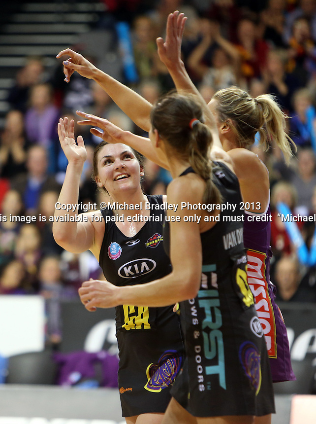 30.06.2013 Magic's Ellen Halpenny in action during the ANZ Champs Preliminary Semi Final netball match between the Magic and Firebirds played at Claudelands Arena in Hamilton. Mandatory Photo Credit ©Michael Bradley.