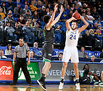 BROOKINGS, SD - DECEMBER 12: Mike Daum #24 from South Dakota State shoots over Billy Brown #3 from North Dakota during their game Tuesday night at Frost Arena in Brookings, SD. (Photo by Dave Eggen/Inertia)