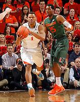 Virginia guard Justin Anderson (1) and Miami guard Garrius Adams (25) during an NCAA basketball game Saturday Feb, 24, 2014 in Charlottesville, VA. Virginia defeated Miami 65-40.