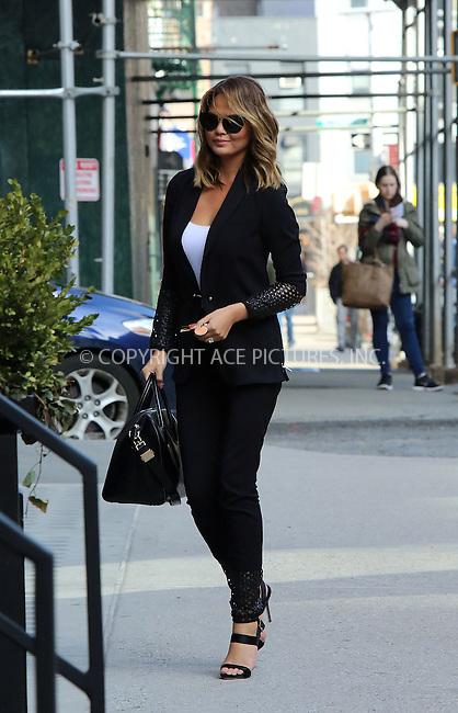 WWW.ACEPIXS.COM<br /> <br /> April 2 2015, New York City<br /> <br /> Model Chrissy Teigen arrives at her Soho apartment on April 2 2015 in New York City<br /> <br /> By Line: Philip Vaughan/ACE Pictures<br /> <br /> ACE Pictures, Inc.<br /> tel: 646 769 0430<br /> Email: info@acepixs.com<br /> www.acepixs.com