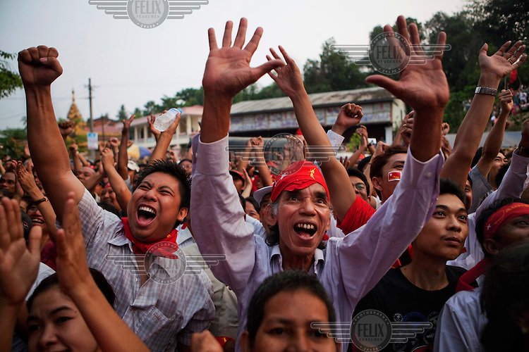 National League for Democracy (NLD) supporters celebrate outside the NLD headquarters as they watch results come in for the by-elections in Yangon.