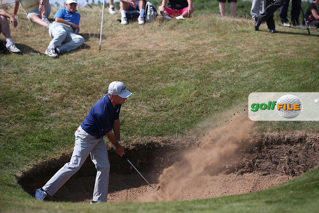 Gary Hallberg (USA) clears the bunker on the 10th during Round One of the 2014 Senior Open Championship presented by Rolex from Royal Porthcawl Golf Club, Porthcawl, Wales. Picture:  David Lloyd / www.golffile.ie