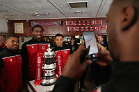 Kingstonian players have their photo taken with the FA Cup during Kingstonian vs AFC Fylde, Emirates FA Cup Football at King George's Field on 30th November 2019