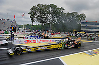 Jun. 1, 2012; Englishtown, NJ, USA: NHRA top fuel dragster driver Morgan Lucas (near) races Antron Brown during qualifying for the Supernationals at Raceway Park. Mandatory Credit: Mark J. Rebilas-